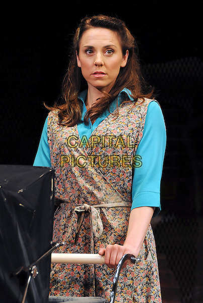 "MELANIE CHISHOLM (Mel C) .as Mrs Johnston .""Blood Brothers"" photocall, Phoenix Theatre, London, England, UK, .October 21st 2009..scene acting on stage set costume musical half length floral wrap dress blue turquoise shirt sleeveless pushing pram  .CAP/CAS.©Bob Cass/Capital Pictures."