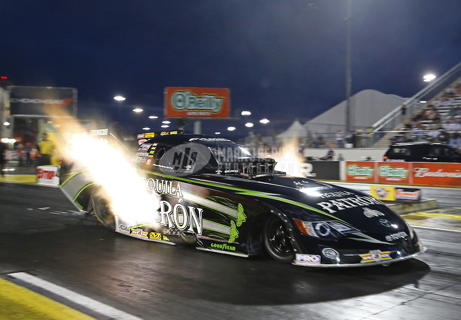 Apr. 5, 2013; Las Vegas, NV, USA: NHRA funny car driver Alexis DeJoria during qualifying for the Summitracing.com Nationals at the Strip at Las Vegas Motor Speedway. Mandatory Credit: Mark J. Rebilas-