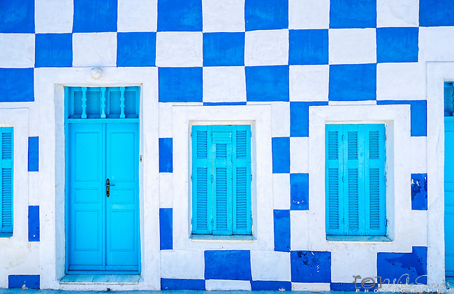 Blue & white chequered house on the island of Therasia, Santorini, Greece