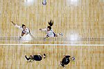 PENSACOLA, FL - DECEMBER 09: Rachael Martin (15), top left, and Anna Tovo (21) of Florida Southern College, center, miss a spike by Shelby Seurer (4) of Concordia University, St. Paul during the Division II Women's Volleyball Championship held at UWF Field House on December 9, 2017 in Pensacola, Florida. (Photo by Timothy Nwachukwu/NCAA Photos via Getty Images)