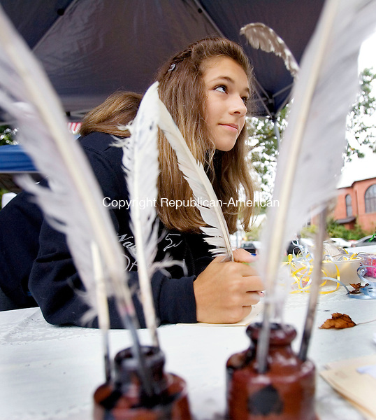 NAUGATUCK, CT. 28 September 2012-092912SV04-Erin Schofield, 13, of Naugatuck writes with a feather and ink at the Naugatuck Historical Society booth during the 2nd Annual All Arts Festival on the green in Naugatuck Saturday. The event was run by the Naugatuck Arts Commission..Steven Valenti Republican-American