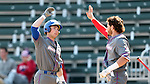 CARY, NC - MARCH 04: UMass Lowell's Austin Young celebrates driving in a run with Steve Passatempo (right). The University of Massachusetts Lowell River Hawks played the University of Notre Dame Fighting Irish on March 4, 2017, at USA Baseball NTC Stadium Field in Cary, NC in a Division I College Baseball game, and part of the Irish Classic tournament. UMass Lowell won the game 8-0.
