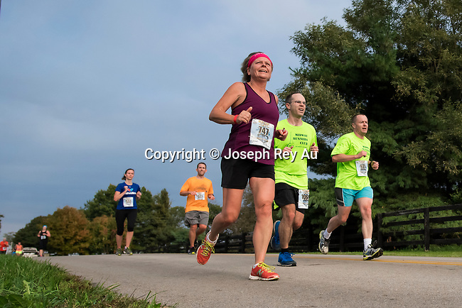 2014 Iron Horse Half-Marathon in Midway, Ky.<br /> Sunday Oct 12, 2014<br /> <br /> Photo by Helena Hau To download complimentary Small or Medium size files, use the password &quot; john 35 &quot;. Larger size digital files and prints are available for purchase.<br /> You do not need a Photoshelter or PayPal account but the order process is streamlined if you have them.