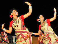 Young girls and boys dancing the Bihu dance during the harvest season. Assam, North East India