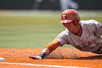 Texas Longhorns outfielder Ben Johnson (14) dives back to first base during the NCAA baseball game against the Houston Cougars on June 6, 2014 at UFCU Disch–Falk Field in Austin, Texas. The Longhorns defeated the Cougars 4-2 in Game 1 of the NCAA Super Regional. (Andrew Woolley/Four Seam Images)