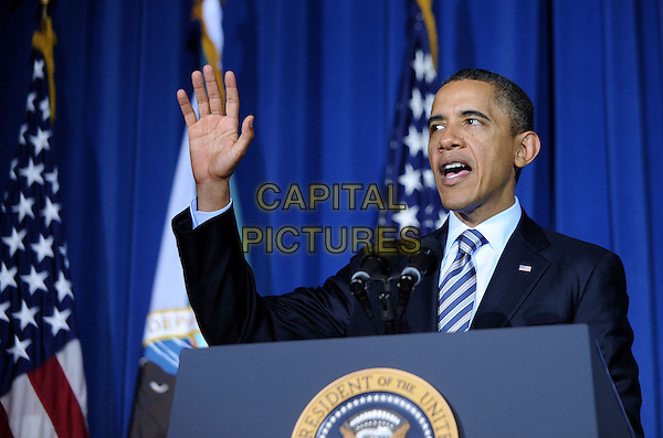 President Barack Obama .speaking at the White House Tribal Nations Conference at the U.S. Department of the Interior, Washington, DC, USA, December 2nd 2011..politics american america portrait headshot  suit tie microphone hand mouth open .CAP/ADM/OD.©Olivier Douliery/Pool/CNP/AdMedia/Capital Pictures..
