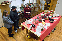NWA Democrat-Gazette/CHARLIE KAIJO Stephanie Smeja and Phil Smeja of Bentonville (from left) listen to Charlotte Sorenson, volunteer tour guide, talk about the kitchen, Friday, November 29, 2019 at the Peel Mansion in Bentonville.<br /> <br /> Christmas decorations adorned the rooms of the Peel Mansion to welcome visitors. The Peel Compton Foundation will host their holiday fundraiser Christmas at the Mansion on December 6 from 6pm to 9pm. Proceeds from the event will help to keep the mansion running and keep admissions costs free. Visitors have enjoyed free admission to the mansion for over a year.