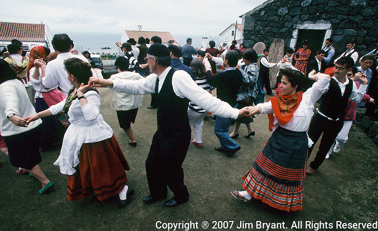 Villagers, dressed in traditional clothing, participate in traditional dances during the festival 'Divino Espirito Santo' which begins on Pentecostal Sunday and last till the end of summer on Terceira, Azores. Far out in the Atlantic Ocean, some 850 miles off the western coast of Lisbon, Portugal lies the 425-mile long archipelago of the Azores. (Jim Bryant Photo).....