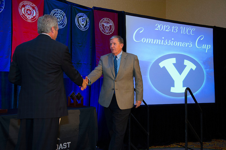 June 5, 2013; Napa, CA, USA; WCC commissioner Jamie Zaninovich (left) awards BYU Cougars university president Cecil O. Samuelson (right) the Commissioner's Cup during the WCC Honors Dinner at the Napa Valley Marriott.