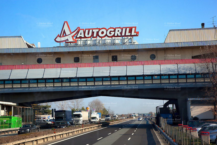 Italy. Piedmont region. Novara Sud. Highway's service area. Autogrill is an Italian-based, multinational catering and retail company, the world's largest in the travel dining sector. The service area is a public facility, located next to a large thoroughfare such as a highway, expressway, or freeway at which drivers and passengers can rest, eat, or refuel without exiting on to secondary roads. 6.12.2011 © 2011 Didier Ruef