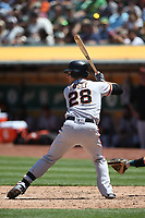OAKLAND, CA - JULY 22:  Buster Posey #28 of the San Francisco Giants bats against the Oakland Athletics during the game at the Oakland Coliseum on Sunday, July 22, 2018 in Oakland, California. (Photo by Brad Mangin)