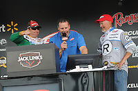 NWA Democrat-Gazette/FLIP PUTTHOFF <br /> Tournament winner Scott Canterbury of Springville Ala., (left) gives a victory fist pump Sunday April 17, 2016 as weigh-in emcee Chris Jones announces Canterbury's five-fish weight. Darrel Robertson of Jay, Okla., (right) finished second 1 pound, 3 ounces behind Canterbury.