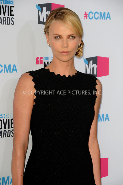 WWW.ACEPIXS.COM . . . . .  ....January 12 2012, LA....Actress Charlize Theron arriving at the 17th Annual Critics Choice Movie Awards at Hollywood Palladium on January 12, 2012 in Hollywood, California....Please byline: PETER WEST - ACE PICTURES.... *** ***..Ace Pictures, Inc:  ..Philip Vaughan (212) 243-8787 or (646) 679 0430..e-mail: info@acepixs.com..web: http://www.acepixs.com