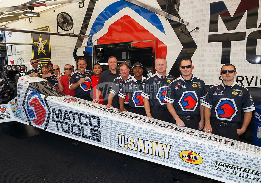 Jun 10, 2017; Englishtown , NJ, USA; NHRA top fuel driver Antron Brown and crew pose for a team photo during qualifying for the Summernationals at Old Bridge Township Raceway Park. Mandatory Credit: Mark J. Rebilas-USA TODAY Sports