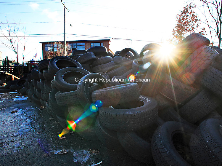 Waterbury, CT-20, January 2010-012010CM02 Abandoned tires occupy the fenceline along Griggs Street in Waterbury.  The tires are located in a lot across from the PAL (Police Activity League) (seen in the background).  Plans to remove the tires are currently in the works.   --      Christopher Massa Republican-American