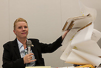 """Rape Survivor and activist, Catherine """"Jane"""" Fisher shows a 6 metre long list of sexual crimes against women that have taken place in Okinawa since 1945 at a press conference to publicise her book in the First Office Building of the Members of the House of Representatives, Nagatacho, Tokyo, Japan, Friday July 18th 2014. Ms Fisher was raped near Yokusuka US Naval Base in Kanagawa in 2002 and has been campaign for the rights of rape victims in Japan since after finding the US Military and Japanese police obstructive and uninterested in bringing her attacker to justice."""