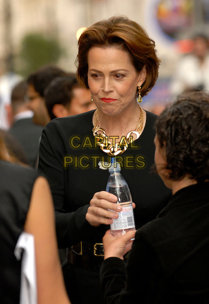 "SIGOURNEY WEAVER.Attending the UK Film Premiere of Disney Pixar's ""Wall-e"" at Empire Cinema Leicester Square, London, England, UK, July 13th 2008..WallE Wall*e Wall.E half length hand drinking water bottle funny mouthful mouth drink.CAP/IA.©Ian Allis/Capital Pictures"