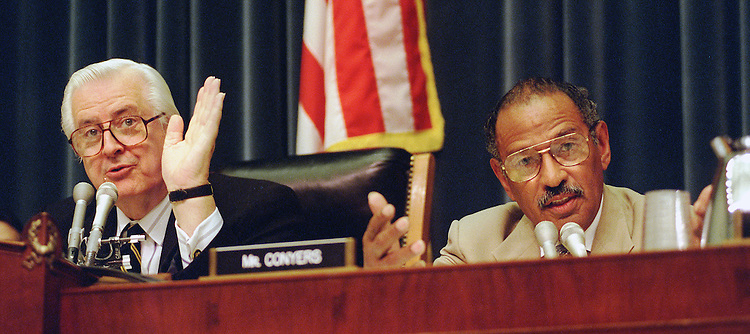 10/15/97.JUDICIARY HEARING--House Judiciary Committee Chairman Henry Hyde, R-Ill., and ranking member John Conyers, D-Mich., talk over each other as they discuss how much time should be allowed for questioning witness Attorney General Janet Reno during an oversight hearing on the Justice Department..CONGRESSIONAL QUARTERLY PHOTO BY SCOTT J. FERRELL