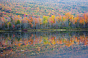 Elbow Pond during the autumn months in Woodstock, New Hampshire. Species of fish in this pond include chain pickerel, yellow perch and smallmouth bass. This area was part of the Gordon Pond Railroad, which was a logging railroad in operation from 1907-1916.