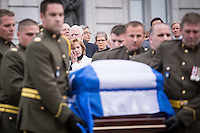 Lisette Lapointe, wife of former Quebec premier Jacques Parizeau, wipes a tear as his casket leaves the National Assembly in Quebec City on Sunday June 7, 2015.