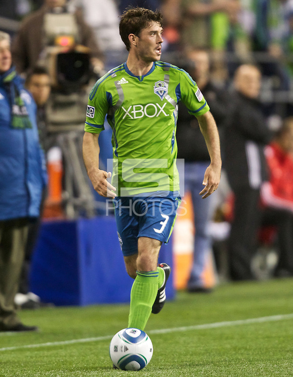 Seattle Sounders FC forward Brad Evans dribbles the ball during play against Toronto FC at Qwest Field in Seattle Saturdcay April 30, 2011. The Sounders won the game 3-0.
