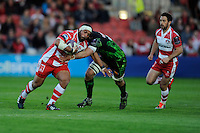 John Afoa of Gloucester Rugby is tackled by Mitch Lees of Exeter Chiefs during the European Rugby Challenge Cup semi final match between Gloucester Rugby and Exeter Chiefs at Kingsholm Stadium on Saturday 18th April 2015 (Photo by Rob Munro)
