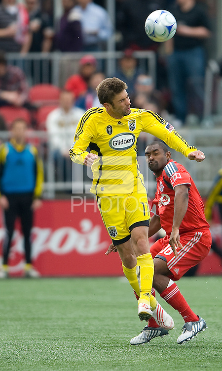 02 May 2009: Columbus Crew forward Pat Noonan #11and Toronto FC defender Marvell Wynne #16  in action at BMO Field in a game between the Columbus Crew and Toronto FC. .The game ended in a 1-1 draw...