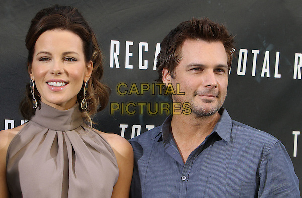 """Kate Beckinsale, Len Wiseman.""""Total Recall"""" - Los Angeles Photo Call Held at The Four Seasons Hotel, Beverly Hills, California, USA, 28th July 2012..portrait headshot hair up earrings beige nude brown high neck husband wife couple .CAP/ADM/KB.©Kevan Brooks/AdMedia/Capital Pictures."""