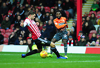 Nathan Dyer of Swansea City cross is diverted in by Chris Mepham of Brentford (not in frame) during the Sky Bet Championship match between Brentford and Swansea City at Griffin Park, Brentford, England, UK. Saturday 08 December 2018