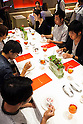 20 lucky customers enjoy eating a McDonald's special dinner created by chef Masayo Waki during a ''Restaurant M'' event in the posh Roppongi Hills area on July 27, 2015, Tokyo, Japan. 20 chosen diners (from 8,300 applications) ate a special multi-course dinner created by the celebrity chef using ingredients from the restaurant chain's regular menu. The special one-night only event was organized to celebrate the launch of its new summer menu ''Fresh Mac,'' which features fresh vegetables. The five-course meal served on a white tablecloth with plates and proper cutlery included a Vichyssoise en Pommes de terre de McDonald, Mousse au Poivron Rouge, Salade en Gelee aux Legumes de McDonald, Cinq Pinchos des McDonald Patties avec leur Sauces, a choice of main dish including the Fresh Mac Bacon Lettuce Burger, and a McFlurry Mixed Berry Oreo dessert with a Premium Roast Coffee. (Photo by Rodrigo Reyes Marin/AFLO)