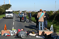 Pictured: Valero refinery workers leave the site on foot after climate protesters blocked access to the site in Pembroke Dock, Wales, UK. Thursday 19 September 2019<br /> Re: Ten Extinction Rebellion climate change protesters have blocked three entrances of the Valero site in Pembroke Dock, Pembrokeshire, one of the biggest oil refineries in Europe.<br /> Protesters have attached themselves to wooden boxes filled with concrete in a bit to stop vehicles from entering or leaving the site.