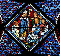 Saint Maximin as bishop of Provence with his crozier, converting people with his preaching, from the Life of Mary Magdalene stained glass window, 13th century, in the nave of Chartres cathedral, Eure-et-Loir, France. Chartres cathedral was built 1194-1250 and is a fine example of Gothic architecture. Most of its windows date from 1205-40 although a few earlier 12th century examples are also intact. It was declared a UNESCO World Heritage Site in 1979. Picture by Manuel Cohen
