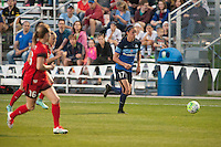 Kansas City, Mo. - Saturday April 23, 2016: FC Kansas City defender Amanda Frisbie (17) brings the ball up the pitch during a match against Portland Thorns FC at Swope Soccer Village. The match ended in a 1-1 draw.