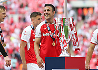 27th May 2018, Wembley Stadium, London, England;  EFL League 1 football, playoff final, Rotherham United versus Shrewsbury Town; Richard Wood of Rotherham United stands alongside the EFL League 1 trophy
