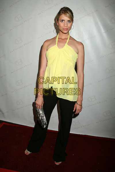 "HOLLY BONELLI.The 2nd Annual ""30 Under 30 Awards"" at The Camden House, Beverly Hills, California, USA..May 3rd, 2007.full length black trousers yellow sheer halterneck top silver clutch purse.CAP/ADM/BP.©Byron Purvis/AdMedia/Capital Pictures"