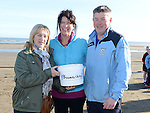 Catriona Culligan, Karen Boyle and Steven O'Reilly collecting at the 5K run on bettystown Beach in aid of Boomerang Cafe. Photo:Colin Bell/pressphotos.ie