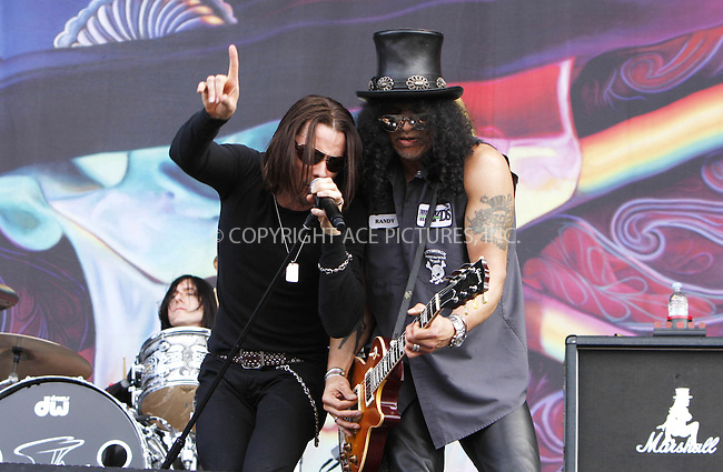 WWW.ACEPIXS.COM . . . . .  ..... . . . . US SALES ONLY . . . . .....Myles Kennedy and Slash perform live during the final day of the Wireless Festival in Hyde Park on July 4, 2010 in London....Please byline: FAMOUS-ACE PICTURES... . . . .  ....Ace Pictures, Inc:  ..tel: (212) 243 8787 or (646) 769 0430..e-mail: info@acepixs.com..web: http://www.acepixs.com