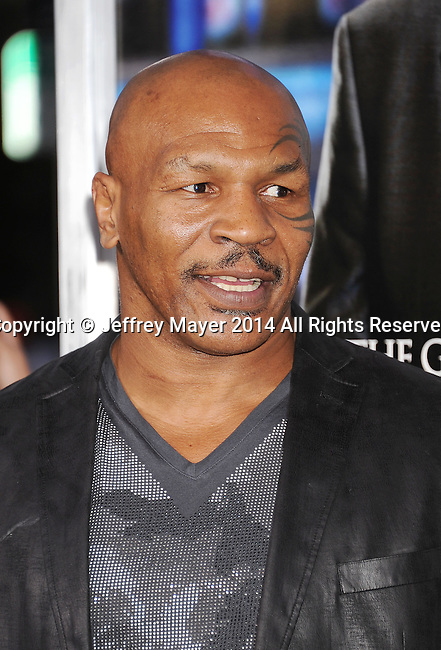 WESTWOOD, CA- APRIL 07: Professional boxer Mike Tyson attends the Los Angeles premiere of 'Draft Day' at the Regency Village Theatre on April 7, 2014 in Westwood, California.