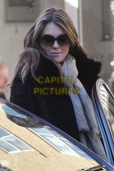 Elizabeth Hurley spotted in South West London, England..November 14th, 2012.liz half length beige denim sunglasses shades fur jacket black grey gray scarf beige .CAP/HIL.©John Hillcoat/Capital Pictures .