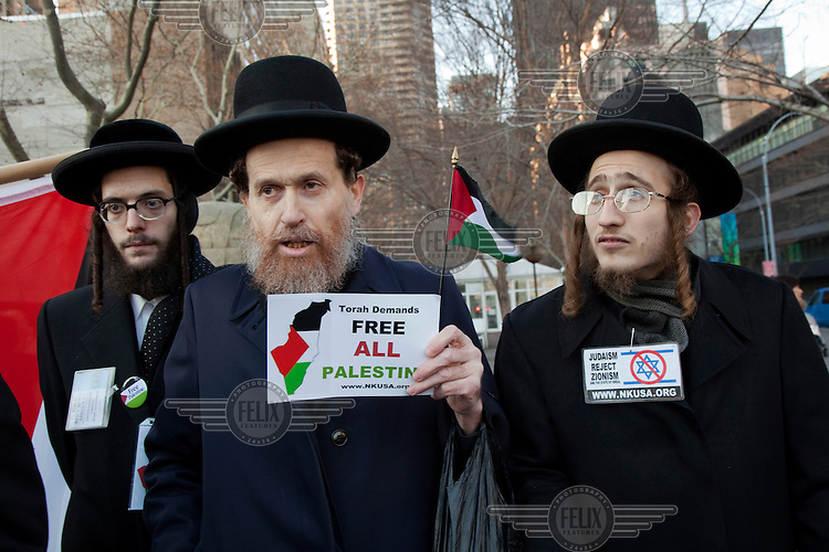 Orthodox Jews from the organization Neturei Karta International gather near the United Nations in Manhattan to show their support for a resolution in the General Assembly to upgrade Palestine to a non-member observer state of the U.N. The resolution was passed by a vote of 138 countries in favour and nine opposed. This group of Orthodox Jews does not recognize the state of Israel and believes all of Israel and the West Bank should be a Palestinian State. Their interpretation of the Torah is that Jews must remain a people in exile until they are redeemed by God but that they can live in Palestine and co-exist in harmony with Palestinians as they did before the rise of the Zionist movement.