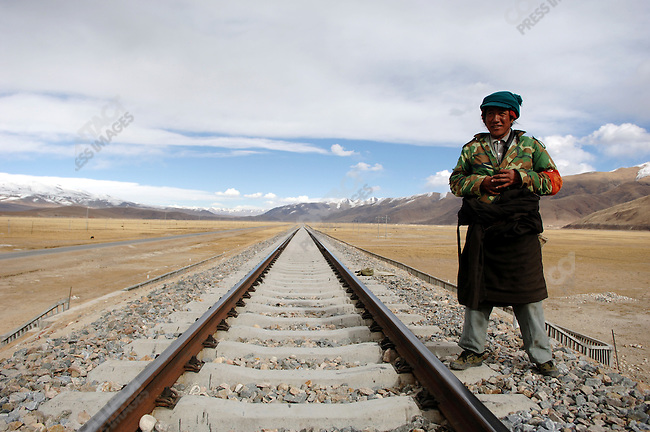 A man stood guard on a section just north of the Tibetan capital of the railway between Lhasa and Golmud, which opened in July 2006, and which connects the Tibetan capital to the major cities of China. November 18, 2006