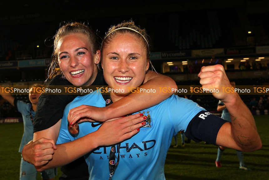 Steph Houghton (R) and Toni Duggan of Manchester City celebrate their win - Arsenal Ladies vs Manchester City Ladies - FA Womens Super League Continental Cup Final Football at Adams Park, Wycombe Wanderers FC  - 16/10/14 - MANDATORY CREDIT: Gavin Ellis/TGSPHOTO - Self billing applies where appropriate - contact@tgsphoto.co.uk - NO UNPAID USE