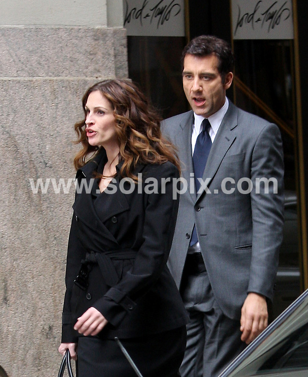 "**ALL ROUND PICTURES FROM SOLARPIX.COM**.**SYNDICATION RIGHTS FOR UK, SPAIN, PORTUGAL, AUSTRALIA, S.AFRICA & DUBAI (U.A.E) ONLY**.""Duplicity"" Filming on Location at Lord & Taylor in New York City, New York, USA. 14th April 2008..This pic: Julia Roberts and Clive Owen..JOB REF: 6145 PHZ/Janet Mayer    DATE: 14_04_2008.**MUST CREDIT SOLARPIX.COM OR DOUBLE FEE WILL BE CHARGED* *UNDER NO CIRCUMSTANCES IS THIS IMAGE TO BE REPRODUCED FOR ANY ONLINE EDITION WITHOUT PRIOR PERMISSION*"