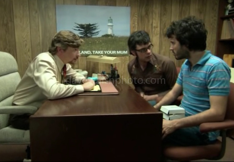Image of Lighthouse in Tiritiri Matangi used in HBO Series Flight of the Conchords. Photograph on wall of Murray Hewitt's office taken by Dave Walsh<br /> <br /> &quot;New Zealand: Take Your Mum&quot;, episode #17 (Series 2, episode 5) &quot;Unnatural Love&quot;