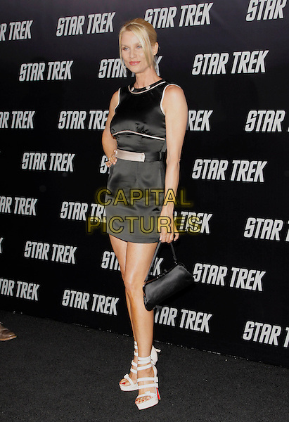 "NICOLLETTE SHERIDAN.The Paramount Pictures L.A. Premiere of ""Star Trek"" held at The Grauman's Chinese Theatre in Hollywood, California, USA. .April 30th, 2009.full length black pink trim dress hand on hip platform white sandals shoes bag purse sleeveless .CAP/DVS.©Debbie VanStory/Capital Pictures."