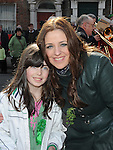 "Grace Owens pictured with Star of ""The Voice' Sharon gaynor at the Drogheda St. Patrick's day parade. Photo: Colin Bell/pressphotos.ie"
