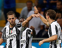 Calcio, Serie A: Inter vs Juventus. Milano, stadio San Siro, 18 settembre 2016.<br /> Juventus' Stephan Lichsteiner, right, celebrates with teammate Miralem Pjanic after scoring during the Italian Serie A football match between FC Inter and Juventus at Milan's San Siro stadium, 18 September 2016.<br /> UPDATE IMAGES PRESS/Isabella Bonotto
