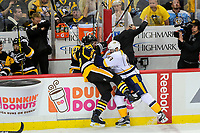 May 29, 2017: Nashville Predators center Vernon Fiddler (83) checks Pittsburgh Penguins defenseman Ron Hainsey (65) into the boards during game one of the National Hockey League Stanley Cup Finals between the Nashville Predators  and the Pittsburgh Penguins, held at PPG Paints Arena, in Pittsburgh, PA. Pittsburgh defeats Nashville 5-3 in regulation time.  Eric Canha/CSM