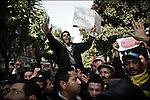 "© Remi OCHLIK/IP3 - Tunis the 17 january 2011 - Protestors demonstrate in the street of Tunis..Tunisia took a step toward democracy and reconciliation Monday, promising to free political prisoners and opening its government to opposition forces long shut out of power -- but the old guard held onto the key posts, angering protesters..Demonstrators carrying signs reading ""GET OUT! demanded that the former ruling party be banished altogether -- a sign more troubles lie ahead for the new unity government as security forces struggle to contain violent reprisals, shootings and looting three days after the country's longtime president fled under pressure from the streets."