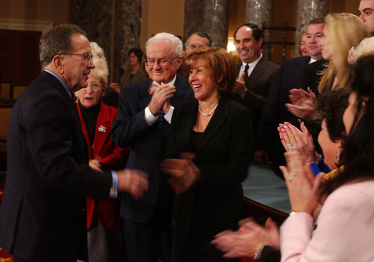 senateswearin10/010703 -- Sen. Ted Stevens, R-Alaska, is welcomed by family and staff before his mock swear in into the 108th Congress by Vice President Dick Cheney in the Old Senate Chamber.